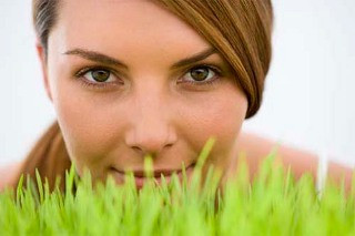Woman looking over grass